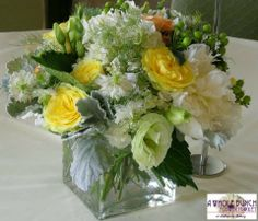 Nice mix of yellows, greens and whites with other seasonal flowers.