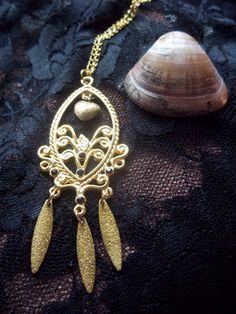Corrente dourada com pingente <br>Pingente mede 08,00 cm