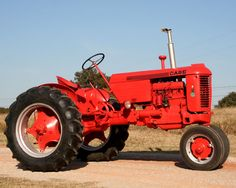 Growing up, my Grandpa gave me a toy tractor every year for my birthday. Ahh. My favorite one looks just like this.