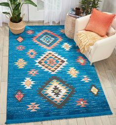 Native American textile designs bring tribal rug decor home with the exciting Navajo Collection of area rugs. The bright transitional hues in these colorful rugs imbue their vivid geometric designs with a sense of animation, and make a stunning color s Area Rug Sizes, Blue Area Rugs, Tribal Bedding, Southwestern Area Rugs, Southwestern Style, Tribal Decor, Navajo Rugs, Blue Carpet, Aztec Rug