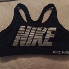 Nike Sports Bra Only worn once! Given to me as a gift but didn't fit properly! Super sporty and cute! Nike Intimates & Sleepwear Bras