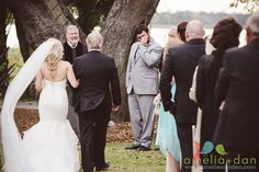 An emotional groom waits for his bride to come down the aisle at this romantic event at Lowndes Grove Plantation @pphgcharleston