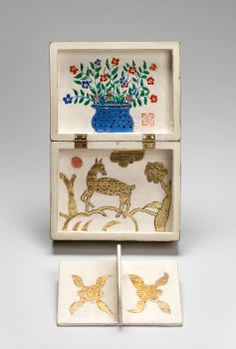 Box by Charles Prendergast  ca. 1934 at Williams College Museum of Art. The decorative motifs that Charles used gives the object a primitive or folk art appearance.