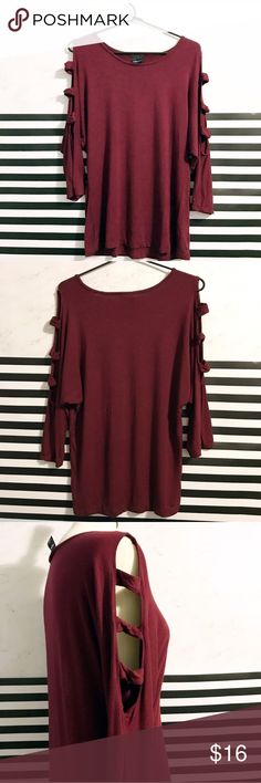 Burgundy red ladder arm cold shoulder top Burgundy red ladder arm cold shoulder top / blouse / shirt. About 3/4 length arms that have cute cutouts down the side. Material is very soft and comfortable. FADT SHIPPING Tops