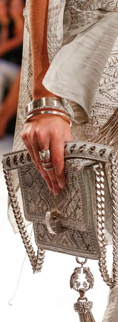 Roberto Cavalli Spring 2014...I know someone who would be thrilled to have a purse like that..I wish I could afford to buy it for her....