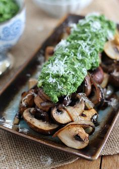 These sweet caramelized mushrooms are served with a bright kale, spinach and avocado pesto.