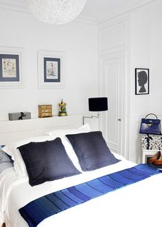 the amount of white in this room is perfection... Sophisticated blue and natural textural accents