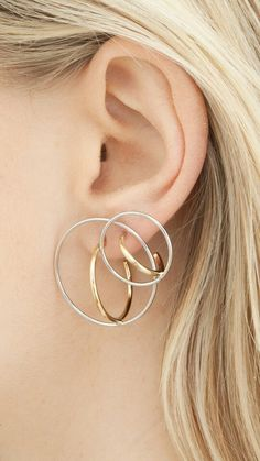 silver and gold earrings: sculptural jewellery by charlotte chesnais