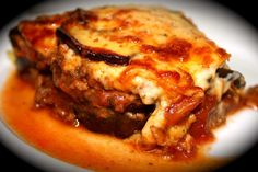 Thick slices of eggplant replace pasta in this traditional Greek favourite.layered with a rich lamb and tom. Lamb Dinner, Moussaka, Bechamel, Tomato Sauce, Cooking Time, Eggplant, Spices, Pork, Tasty