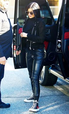 Kylie Jenner's Trick to Make Sweatpants Look Expensive - Kylie Jenner wears a turtleneck, suede moto jacket, leather joggers, high-top sneakers, and Dior su - Mode Kylie Jenner, Trajes Kylie Jenner, Looks Kylie Jenner, Kendall Jenner Outfits, Kylie Jenner Grunge, Kyle Jenner, Khloe Kardashian, Kardashian Kollection, How To Wear Joggers