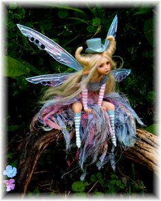 Blue and pink fairy by Celia Harris ... has a bit of a steampunk look to her