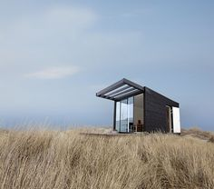 swedish beach style house by lars frank nielsen. these can also be linked to create larger living spaces