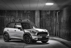 A MINI Cooper S Countryman with contrasting roof and mirrors and bonnet stripes.