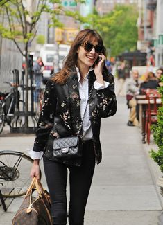 dcf958efb283 Alexa Chung carries a Chanel Mini Classic Flap Bag and Louis Vuitton Mon  Monogram Keepall Bag
