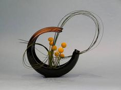 Ikebana is the Japanese art of flower arrangement - so elegant and one of my favorite artistic expressions.