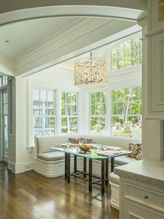 The large windows in this room make this lovely breakfast nook nice and bright!   What do you think of this built-in dining area?