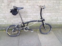 """Jon's custom Brompton: """"I've finally finished the last bout of daft blinging which I thought I'd share. In total that's a new bottom bracket, cranks, chain, clamps, rims, spokes, cables, brake levers, carbon bars, bar ends and mudguards and the best..."""