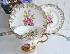 Pink Roses Gold Teacup Trio Cup And Saucer With Plate Rosina Gold Overlay Pink Tea Cups, China Cups And Saucers, Chocolate Cups, Cup And Saucer Set, Rose Design, Afternoon Tea, Bone China, Pink Roses, Pretty In Pink