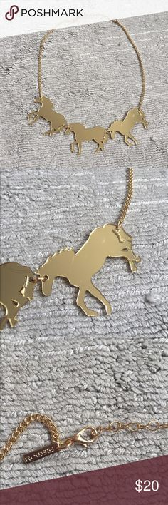 "Topshop Running Horses Necklace Fun and bright! Can be reversible and worn on silver side. Horse has slight smudges a s markings. Image shows detail. Not highly visible once work. Acrylic horses, metal adjustable chain. Each horse is 1.5"" H and 2"" L. 17.25"" L with additional 2"" for desired length Topshop Jewelry Necklaces"