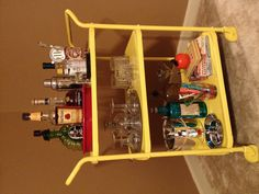 Vintage Bar Cart  The majority of all these items were purchased at local antique stores in Celina,Tn.My cart is an old hospital cart that I painted yellow.The Don Ho glass is my favorite.He was a staple of Hawaii in the 60's and no trip to the Aloha State was complete w/out seeing Don Ho.