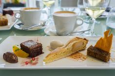 plate: L-R: flourless chocolate cake with chocolate marquise; pear ...