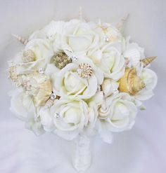 Seashell Wedding Bouquet from www.wedideas.com . All Naural Touch Roses and Real Seashells. Perfect Beach Wedding Bouquet.