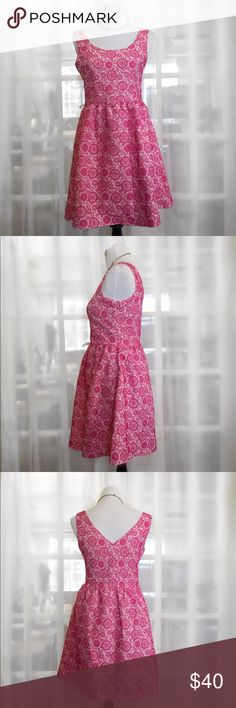 Miami Pink and White Print Fit and Flare Dress This absolutely lovely dress by Miami features a scooped neckline, sleeveless, fitted waist, pleated flared skirt and a feminine v back. Pair with a fitted jacket for work or add some sparkling jewelry for a festive event! Like New! miami Dresses Midi