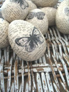 Easter - love the bookpage eggs with printed butterflies - silhouettes would be nice too #Easter #altered #bookpage ≈√