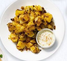 Spicy fried potatoes with soured cream for dipping, great as part of a Tex-Mex meal