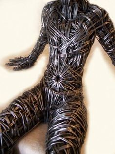 British sculptor Richard Stainthorp captures the beautiful energy and fluidity of the human body using wire. The life-sized sculptures feature both figures in motion and at rest, expressed in the form of large-gauged strands that are densely wrapped around and through one another. By doing this, he gives the work an undeniable presence. Stainthorp also allows the bent wires to shine by keeping their metallic appearance free from any obvious painting or additions.