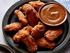 Nadia G's habanero-based Tsaketa Hot Sauce makes these wings some of the best ever.