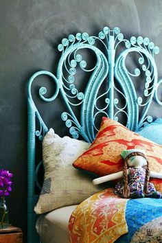 soft blue painted iron filigree headboard. gorgeous