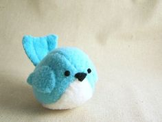 This little plush bluebird stuffed animal is all sewn together by hand out of bright aqua blue polyester