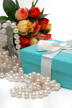Mixed rose bouquet with string of pearls and blue gift box