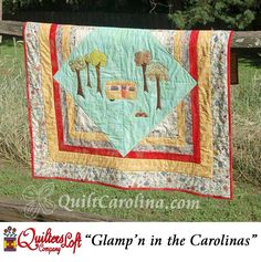 """""""Glamp'n in the Carolinas"""" – this wonderful wall hanging size quilt uses appliqué to create a charming glamour camping, or glamping, scene with simple construction for the background! A 2017 Quilt! Carolina pattern."""