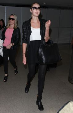 Candice Swanepoel arrived at the airport looking cool in a black-and-white dress topped with a black leather biker jacket. @candiceswanepoel
