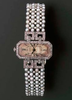 A LADY'S ART DECO DIAMOND AND PEARL WRISTWATCH, BY CARTIER  The cut-cornered rectangular cream dial with black Roman numerals within rose-cut diamond border and winder, set perpendicular to the square openwork diamond shoulders, seed pearl mesh bracelet and diamond panel shoulers, buckle deployant clasp, circa 1915, 16.3 cm. inner length, with French assay mark for gold Dial signed Cartier Paris, nos. 11020 and 3979 to reverse.