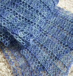 Free Knitting Pattern for One-Row Repeat Marmalade Scarf - Easy lace scarf with a one row repeat. Designed by Angela Juergens who says you can get a nice sized scarf with one skein of yarn. Pictured project by devonnejoy