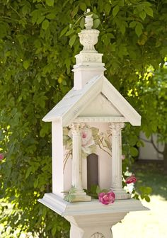 Vintage birdhouse with roses