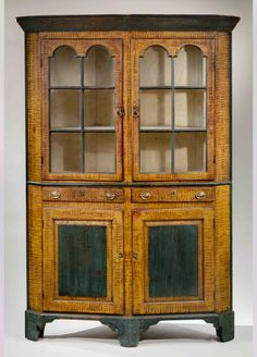 """Paint-Decorated """"Turkey-Breast"""" Corner Cupboard  Probably Columbia County, Pennsylvania, circa 1820  White pine, paint, iron hinges, brass handles and escutcheons, glass, 79 ½ x 51 x 21 ½ inches. Retains original painted . Collection H. William Koch, Turbotville, PA; """"Fine American Furniture, Silver and Decorative Arts,"""" Christies, New York, January 22, 1983, lot 452, sold for $44,000, a world record price for American painted furniture at that time. Austin T. Miller  American Antiques Inc."""