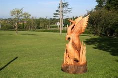 A sculpture titled 'Herons/Phoenix Birds (Carved Wood life size garden sculpture statue)' by artist Ray McCullough in the category Birds Sculptures or Statues. This sculpture has the dimensions of 5 ft x 2 ft x 2 ft and is an edition number of 2nd, the sculpture is sculpted from a medium of 'Ash or Beech'. Herons / Phoenix Birds Carved Ash and Spalted Beech Wood sculpture statue for sale for Outside Exterior Outdoors in the Garden or Back Yard by Ray McCollough