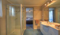The Spa Condo bathrooms are gorgeous! Condo Bathroom, Bathrooms, Spa, Mirror, Furniture, Home Decor, Decoration Home, Bathroom, Room Decor