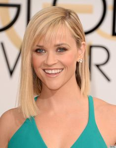 Reese Witherspoon in diamond stud earrings. 2014 Golden Globes