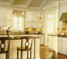 Like the off-white cabinets, crown-molding on top, and backsplash