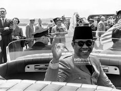 President Sukarno of Indonesia waves during a motorcade on his trip to the United States, Washington DC, May 16, 1956.
