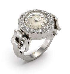 J. Schulz A LADY'S PLATINUM DIAMOND-SET RING WATCH CIRCA 1960 • manual winding nickel lever movement, 17 jewels • silvered dial, applied dagger and dot indexes, crystal with interior faceting around perimeter • diamond-set bezel, snap back, the crown at 12 o'clock wound via a hinged portion of the open-work lug.  Estimate: $4,000 - 5,500