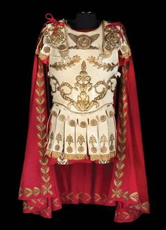 """Richard Burton """"Mark Antony"""" gold embroidered off-white leather tunic and burgundy cape with short sword, by Nino Novarese for Cleopatra. Cleopatra, Roman Armor, Mark Antony, Roman Legion, Armor Clothing, Roman Soldiers, Leather Armor, Fantasy Costumes, Movie Costumes"""