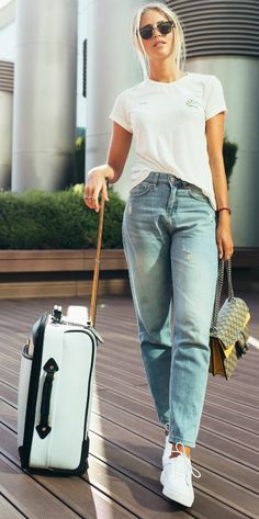 Janni Deler + classic white tee + denim jean + street style staple + great choice for travel + chilled out vibe + dressed up + pair of cool shades + stylish designer handbag  Top: Bik Bok, Jeans: Chiquelle, Bag: Gucci, Shoes: Senso, Travel bag: River Island