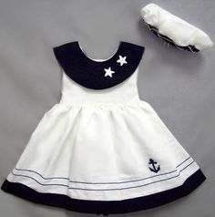 Another cute sailor dress...cute for a more traditional look on a little girl on the beach.  I have one of my daughter Helena wearing one of these at age 2...running on the beach and smiling at the camera...still one of my favorites.  (no red bow on hers...but doesn't matter.)  :-)