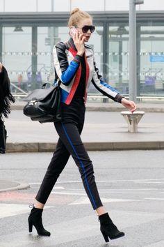 Gigi Hadid wearing Stuart Weitzman Black Suede Mitten Boots, Versace Ryder Bag and Gucci Blooms Iphone Case